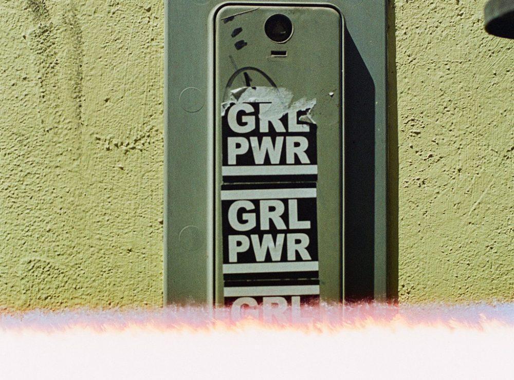 Girls Power written on the wall.