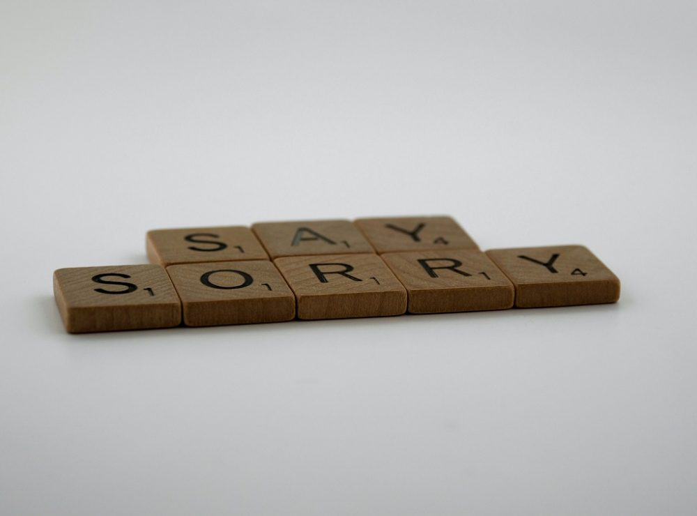 Image with word Sorry written dowm on wooden cubes.